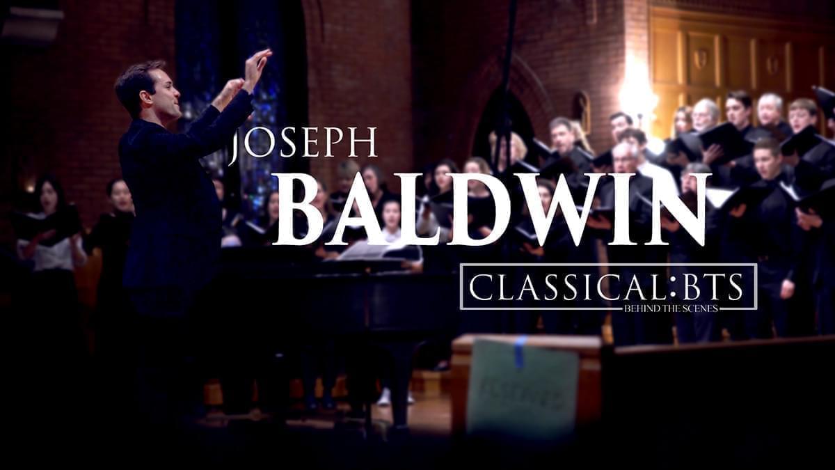 Joseph Baldwin conducting an orchestra