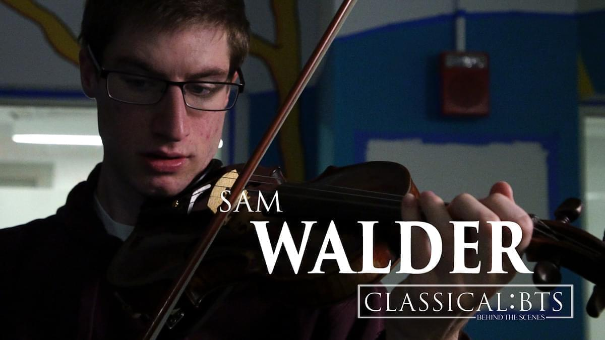 Sam Walder playing a violin