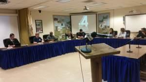 Champaign Unit 4 School Board members seated in their meeting room
