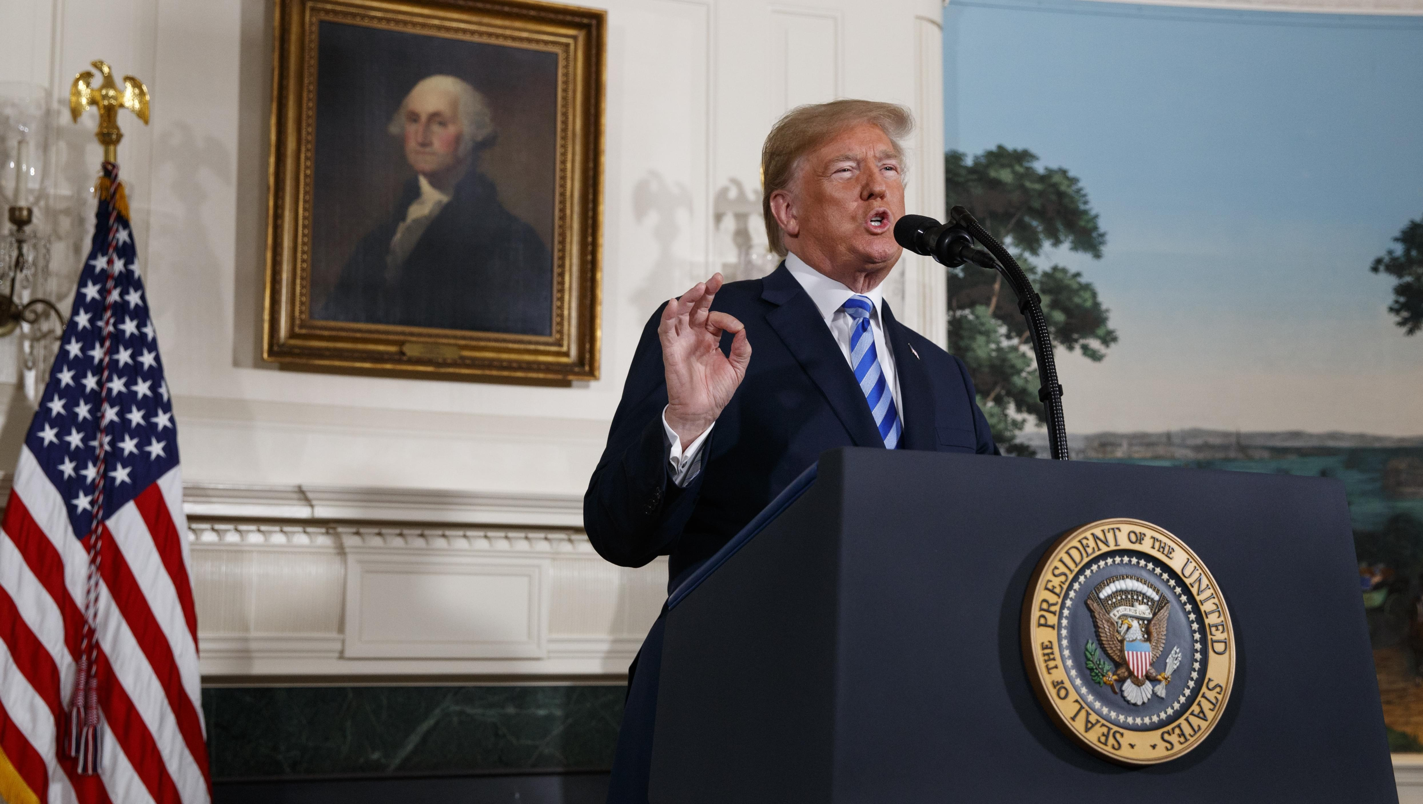 President Donald Trump delivers a statement on the Iran nuclear deal from the Diplomatic Reception Room of the White House,