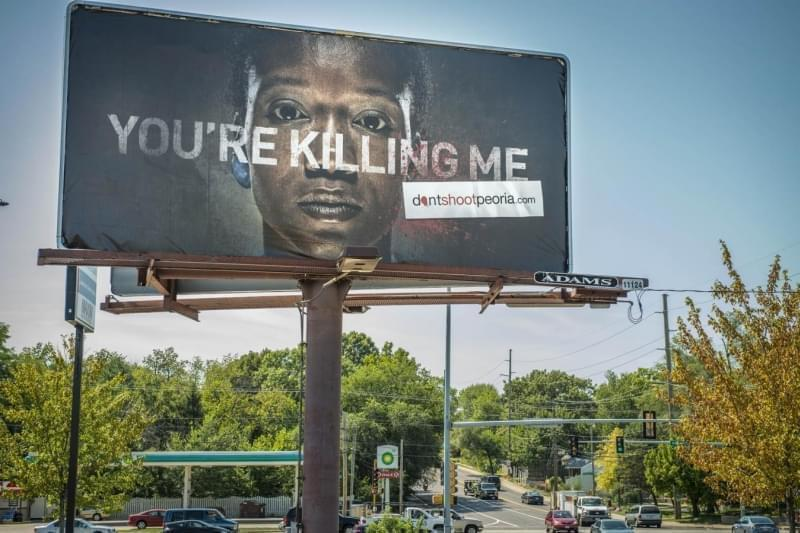 Peoria launched its 'Don't Shoot' initiative with a graphic billboard campaign.