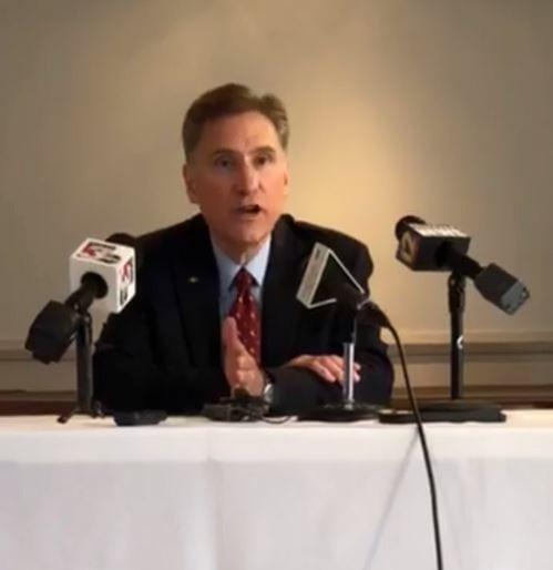 SIU President Randy Dunn speaking into a microphone at a news conference