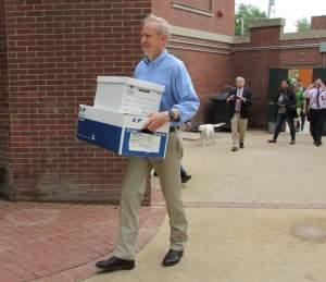 Gov. Bruce Rauner moves a few boxes into his newly-occupied residence at the Governor's Mansion in Springfield