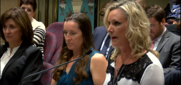 Sarah Powers-Barnhard (left) and Julie Romias (center) testify at the Senate hearing.