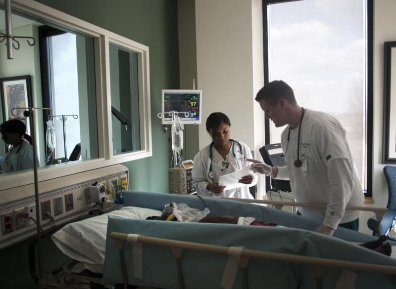 Health care workers in a hospital room