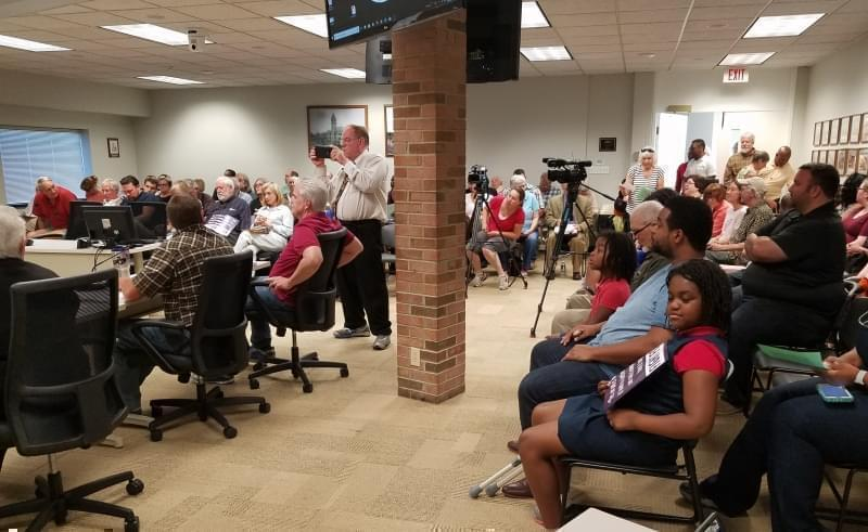 More than 100 people came to the Champaign County Board Room at the Brookens Center in Urbana Tuesday evening.