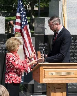 Connie Barr receives her father's Purple Heart from Illinois State Treasurer Michael Frerichs