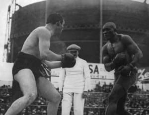 Tommy Burns and Jack Johnson fighting for the heavyweight title in 1908.