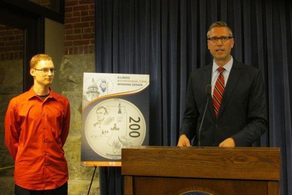 Illinois Treasurer Mike Frerichs announces the winning coin design