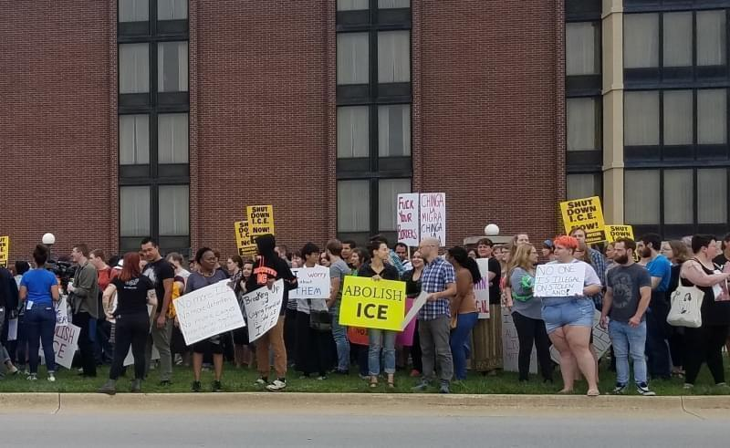 Demonstrators protesting ICE agents outside the Drury Inn & Suites in Champaign.