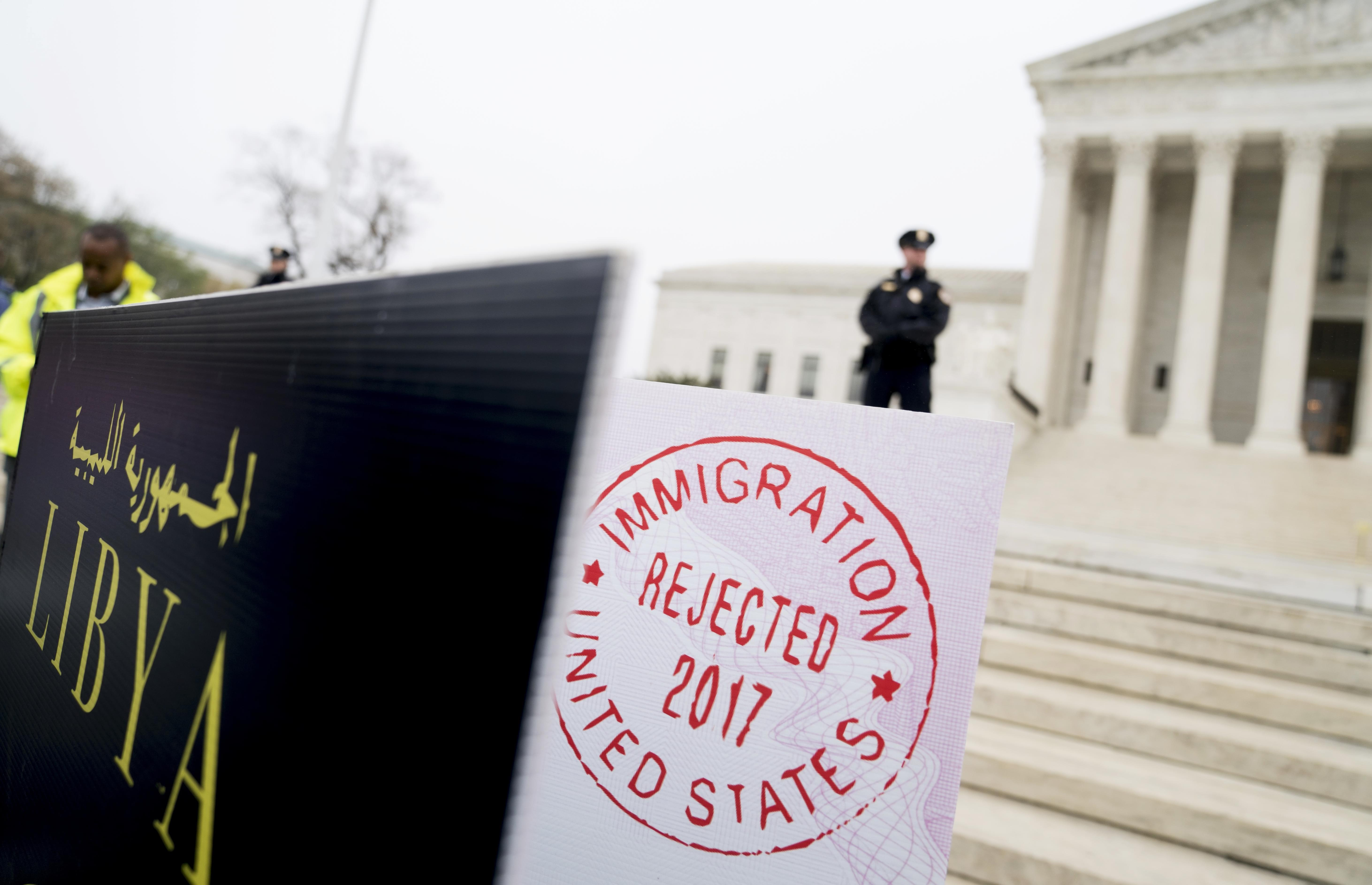 "Poster sized enlargements of passports marked as ""rejected"" by United States Immigration were on display April 25th, during an anti-Muslim ban rally outside the US Supreme Court building in Washington, DC."
