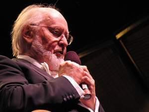 John Williams speaks on a microphone
