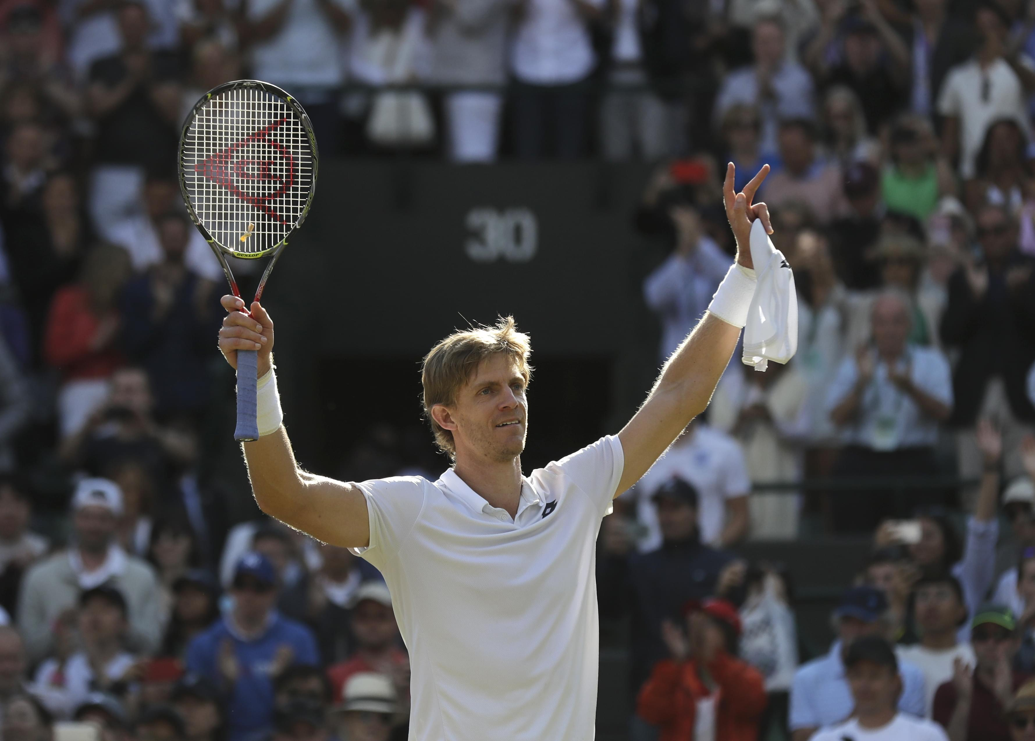 Kevin Anderson of South Africa celebrates winning his men's quarterfinals match against Switzerland's Roger Federer, at the Wimbledon Tennis Championships, in London, Wednesday July 11, 2018.