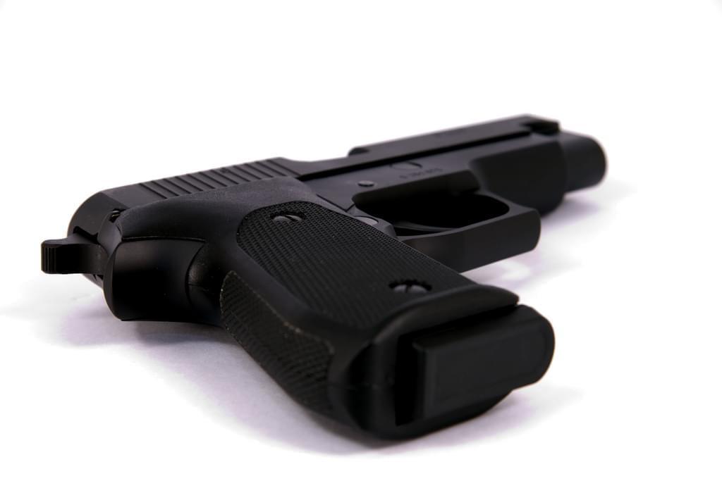 A SIG Sauer P220 45 ACP semiautomatic handgun.