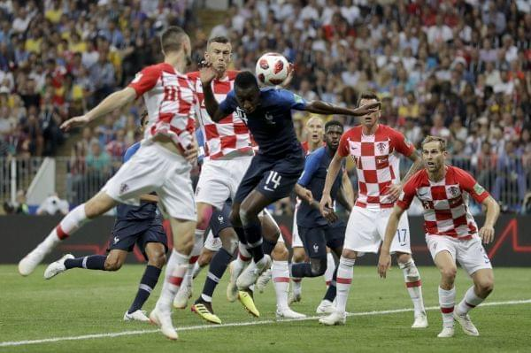 Croatia's Ivan Perisic, second left, handles the ball to give away a penalty as he jumps for the ball with France's Blaise Matuidi during the final match between France and Croatia.