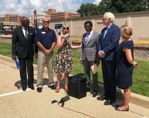 Urbana Mayor Diane Marlin and U Of I Chancellor Robert Jones were among local stakeholders who announced $125,000 in federal funding to study how the Kickapoo Rail Trail could be extended west through downtown Urbana.