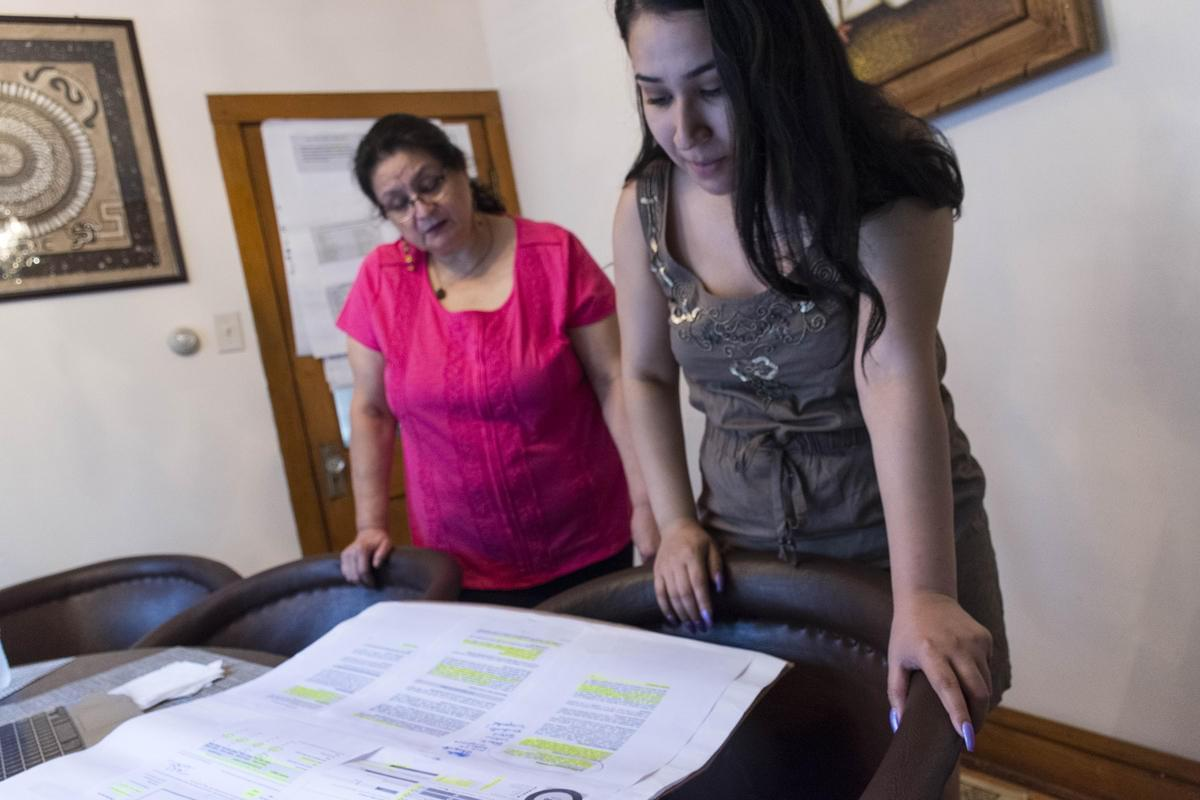Delia Barajas and Elizabeth Morales, members of the community group Ixchel, review materials they've used to educate Cicero and Berwyn residents about school discipline and racial disparities.