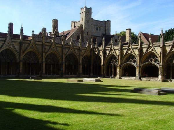 The cloister of Canterbury Cathedral with monastic buildings in the background
