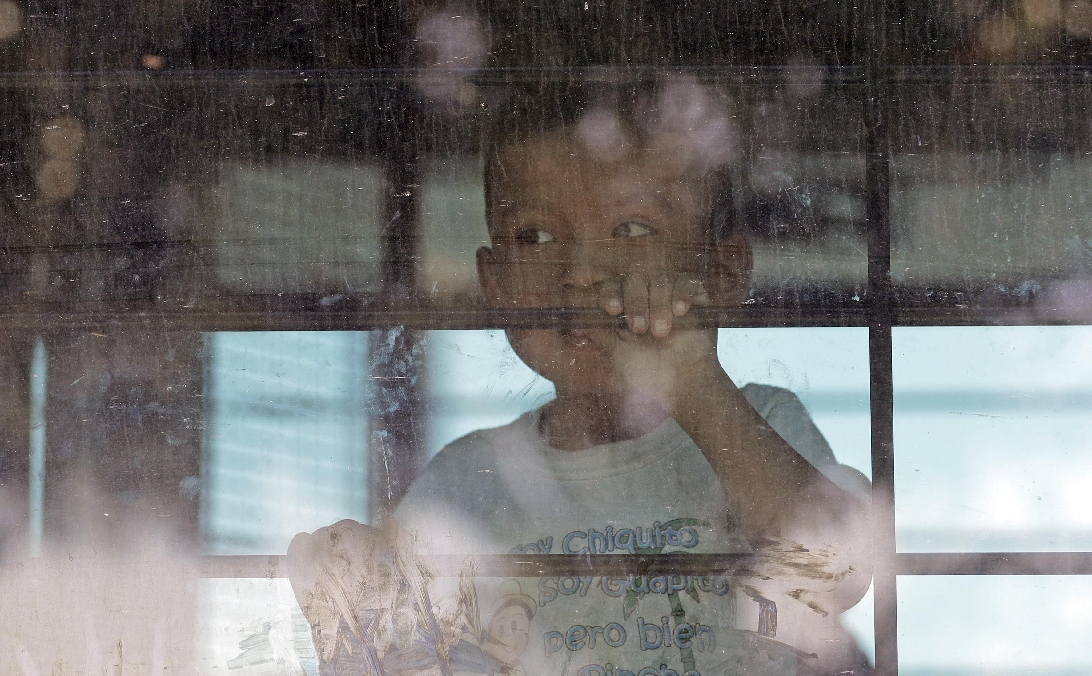 A child looking out a window