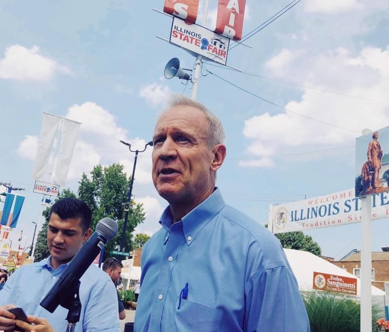 "At a bill signing Monday, Illinois Governor Bruce Rauner continued to point fingers at House Speaker Michael Madigan for what he calls ""illegal activity""."