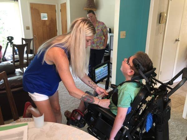 Decatur resident Brandy O'Connor at home with her son, Mark Bolen, 10. Mark has cerebral palsy and O'Connor said she has struggled to find a childcare facility willing and able to care for him.