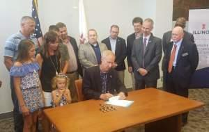 Gov. Bruce Rauner signs bill adding safety measures to People's Gas Manlove Gas Storage Field in Champaign County.