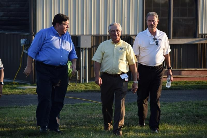 Democratic candidate for governor J.B. Pritzker, left, with Rich Guebert and Mark Gebhards from the Illinois Farm Bureau on Wednesday, Aug. 22, 2018, in Normal.