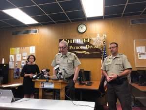 Champaign County State's Attorney Julia Rietz, Champaign County Sheriff Dan Walsh, and Chief Deputy Allen Jones.