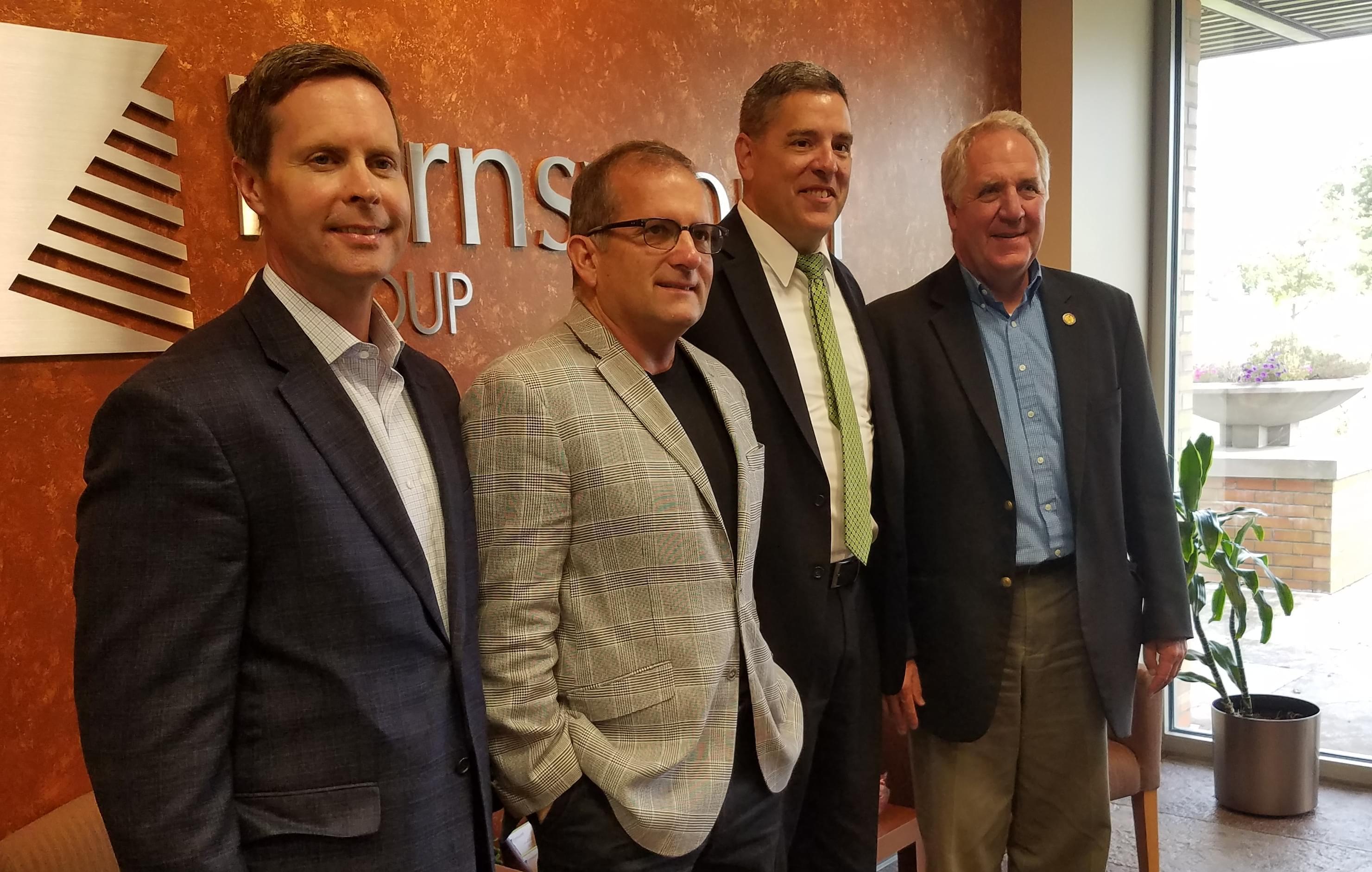 Congressmen Rodney Davis and John Shimkus pose with Farnsworth Group executives Greg Cook & Matt Davidson.