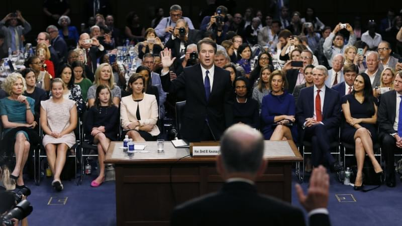 Supreme Court nominee Judge Brett Kavanaugh is sworn in by committee Chairman Chuck Grassley, R-Iowa, to testify during his confirmation hearing on Capitol Hill Tuesday in Washington, D.C.