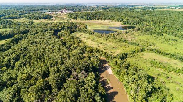 The Middle Fork River running next to the coal ash ponds at the Vermilion Power Station