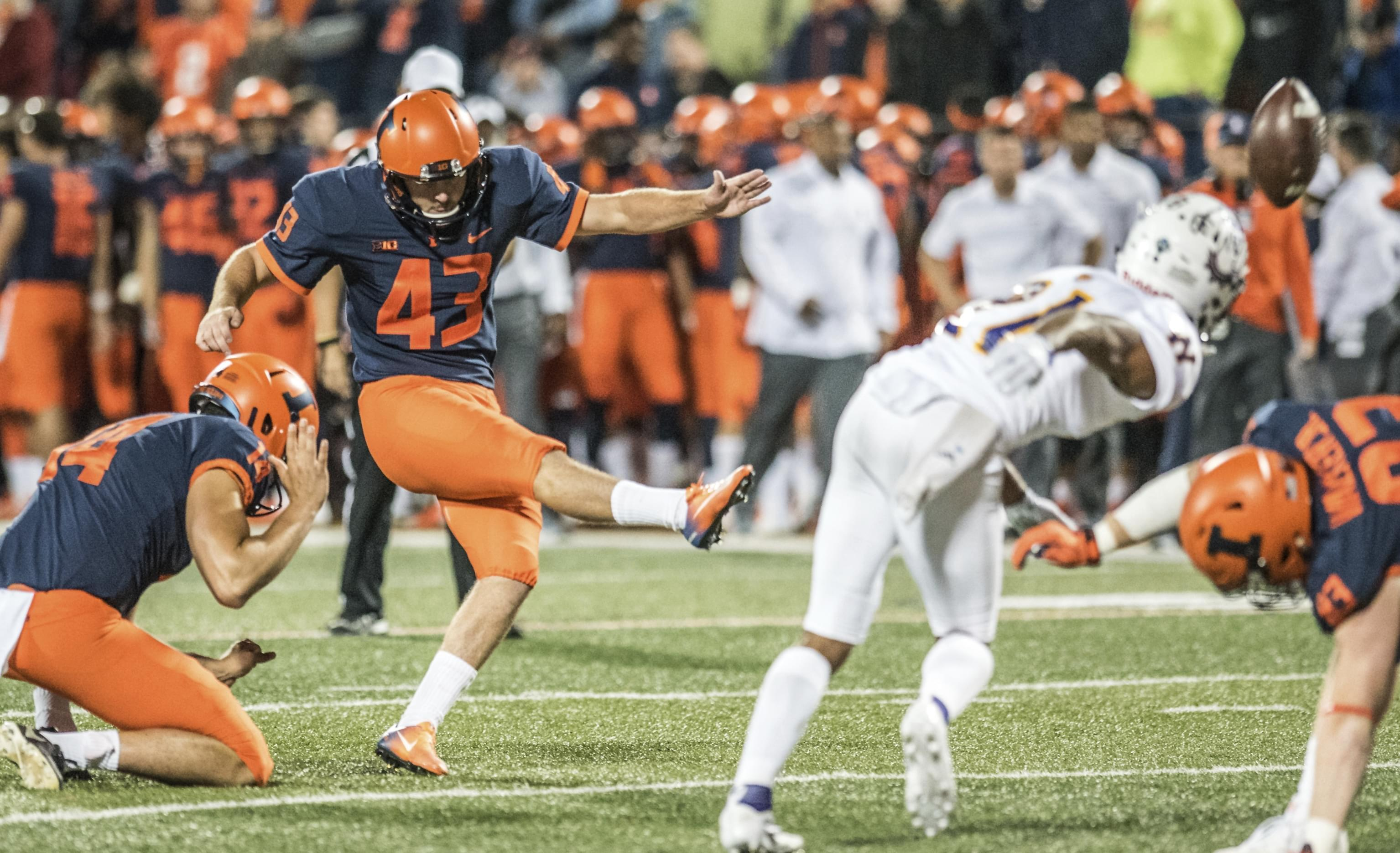 Illinois' Chase McLaughlin kicks an extra point during the first half of their football  game against Western Illinois.
