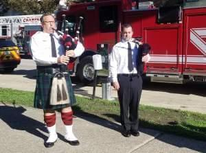 Champaign Fire Department bagpipers, Capt. Todd Hitt and Firefighter Zach Tish.