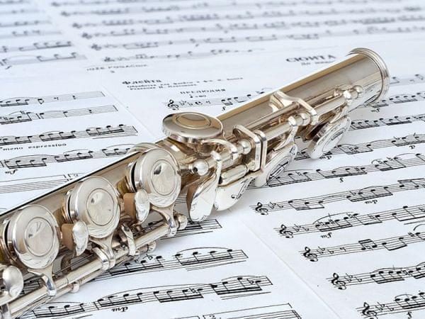 Flute on top of sheets of music.