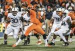 Illinois quarterback MJ Rivers passes the ball.