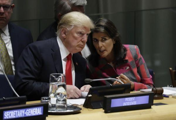 President Donald Trump talks to Nikki Haley, the U.S. ambassador to the United Nations, at the United Nations General Assembly, Monday, Sept. 24, 2018, at U.N. Headquarters.