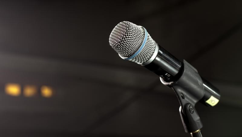 Stock photo of a microphone on a stand.