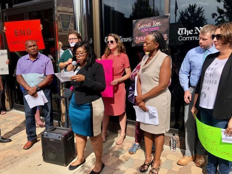 "Tanisha King-Taylor, a Democratic candidate for Champaign County Board, shares her ""#MeToo"" experience during a rally outside of the News-Gazette building on Oct. 1, 2018."