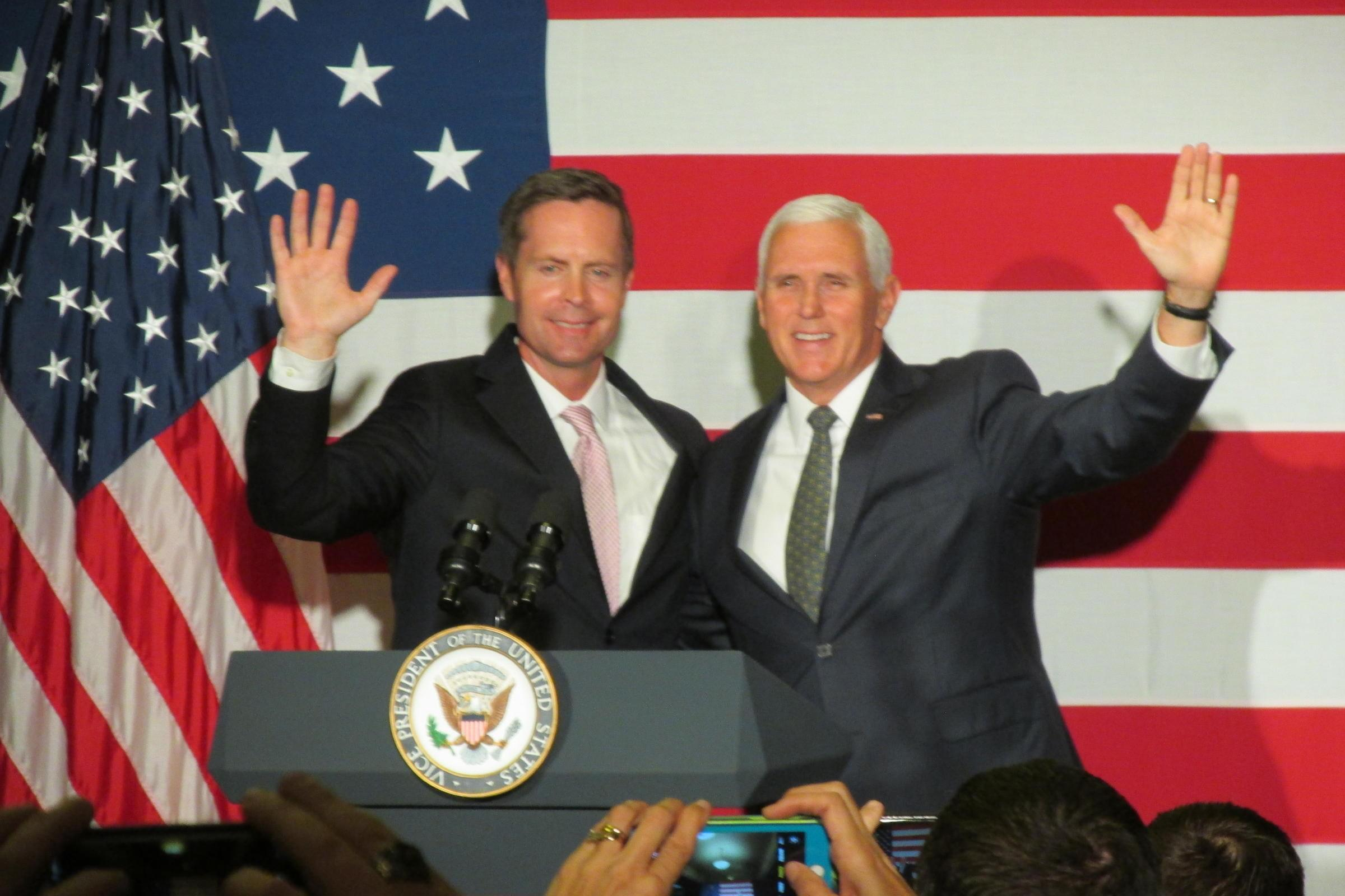 Congressman Rodney Davis, left, greets supporters alongside Vice President Mike Pence at a fundraiser in Springfield on Oct. 12.