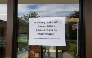 A sign directs people to the Champaign County Clerk's office for early voting.