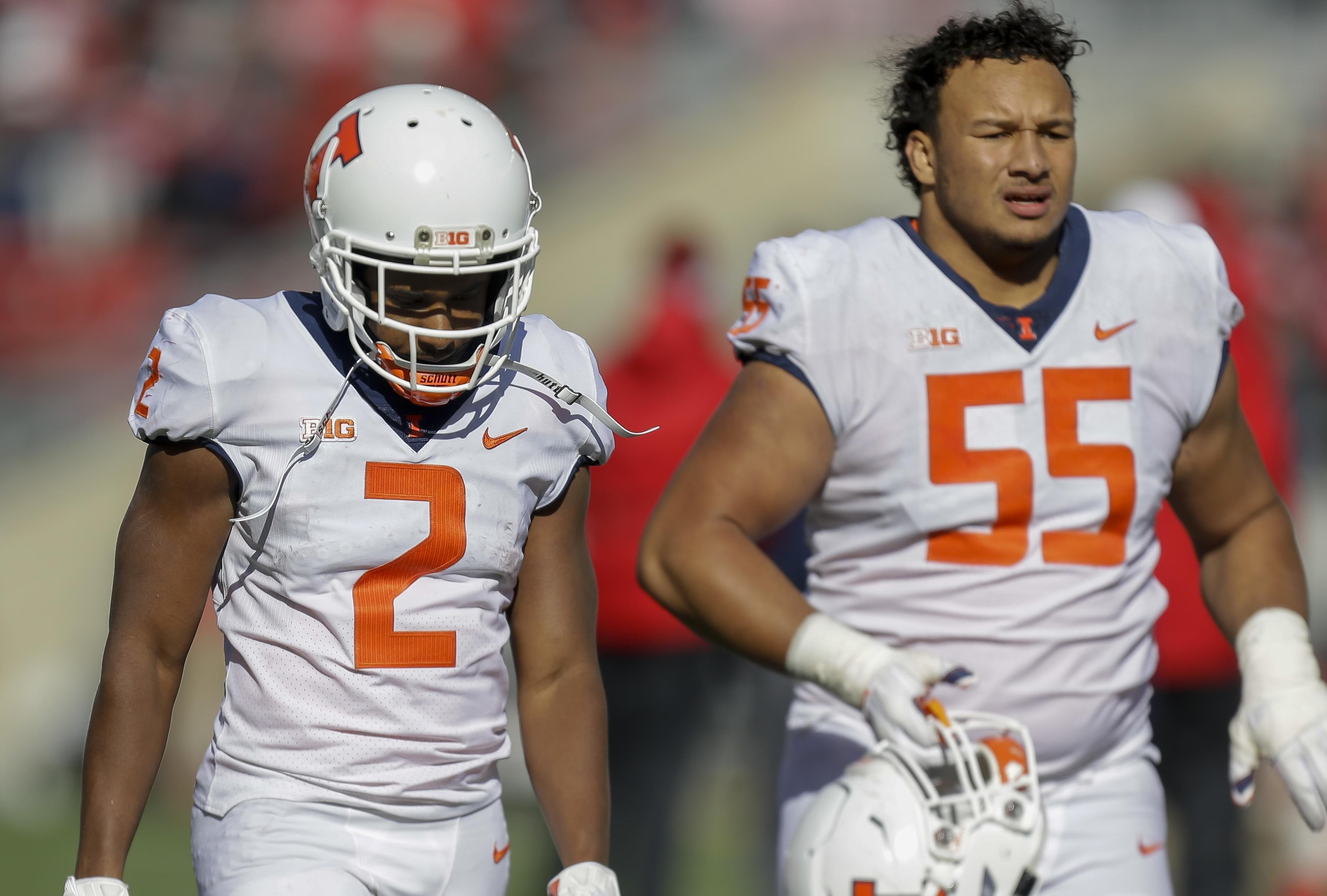 Illinois running back Reggie Corbin and offensive lineman Kendrick Green.