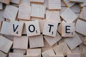 Vote spelled with tiles.