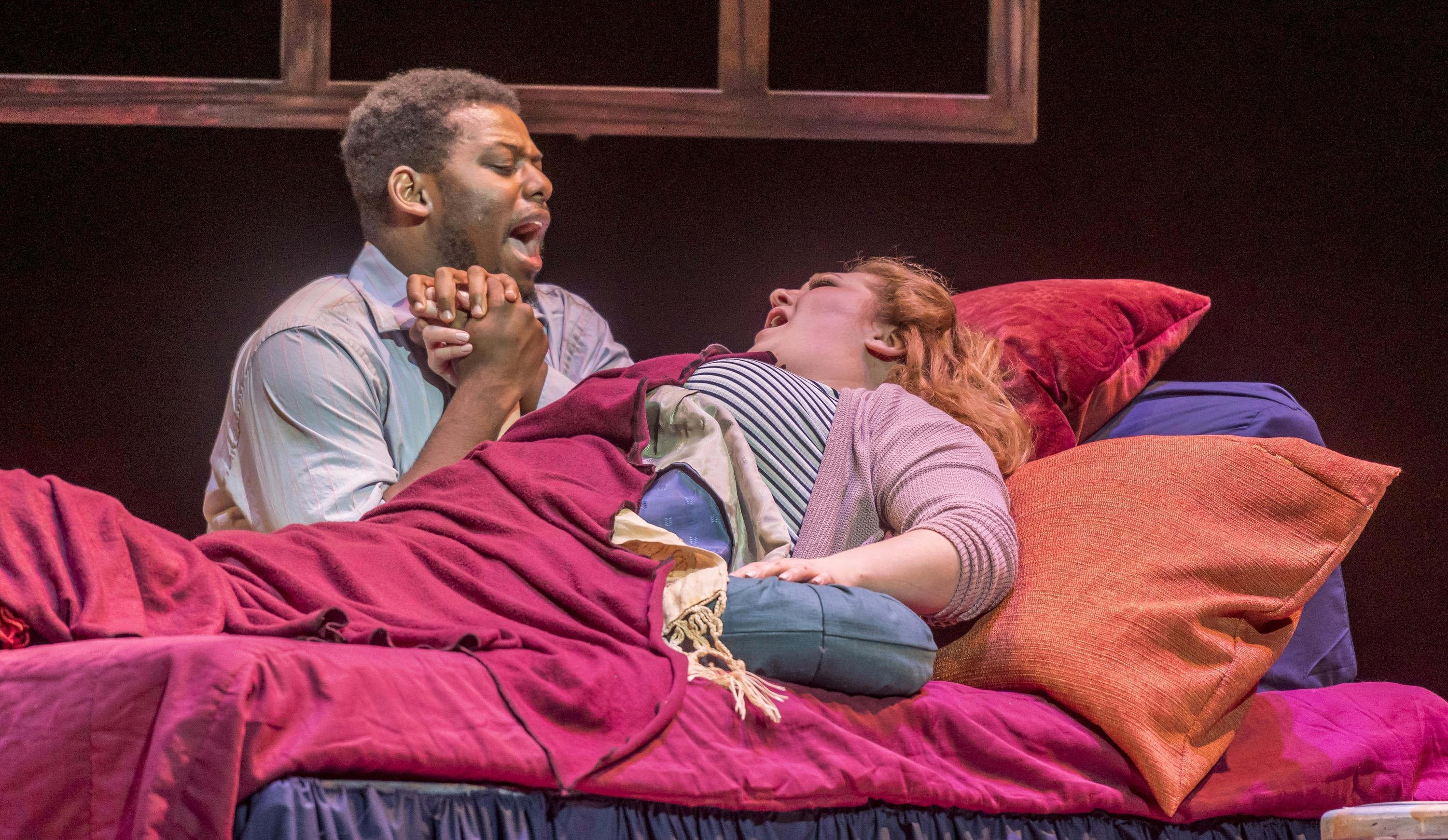 "Rodolfo (Andrew Turner) and Mimi (Kimberly Oulette) in Lyric Theatre's production of ""La Boheme."""