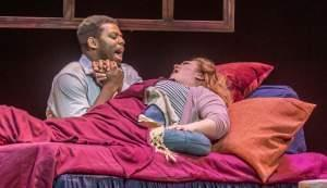 """Rodolfo (Andrew Turner) and Mimi (Kimberly Oulette) in Lyric Theatre's production of """"La Boheme."""""""