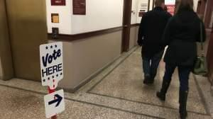 Sangamon County residents vote early at the county building.