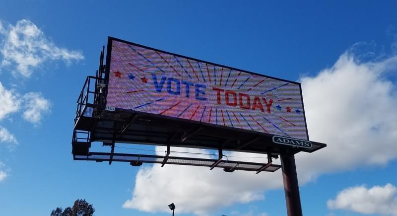 An electronic billboard in Champaign calls on people to vote.