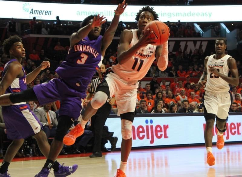 Illini freshman Ayo Dosunmu maneuvers the ball past Evansville's Jawaun Newton.