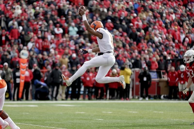 Illinois quarterback AJ Bush Jr leaps inito the end zone for a touchdown.