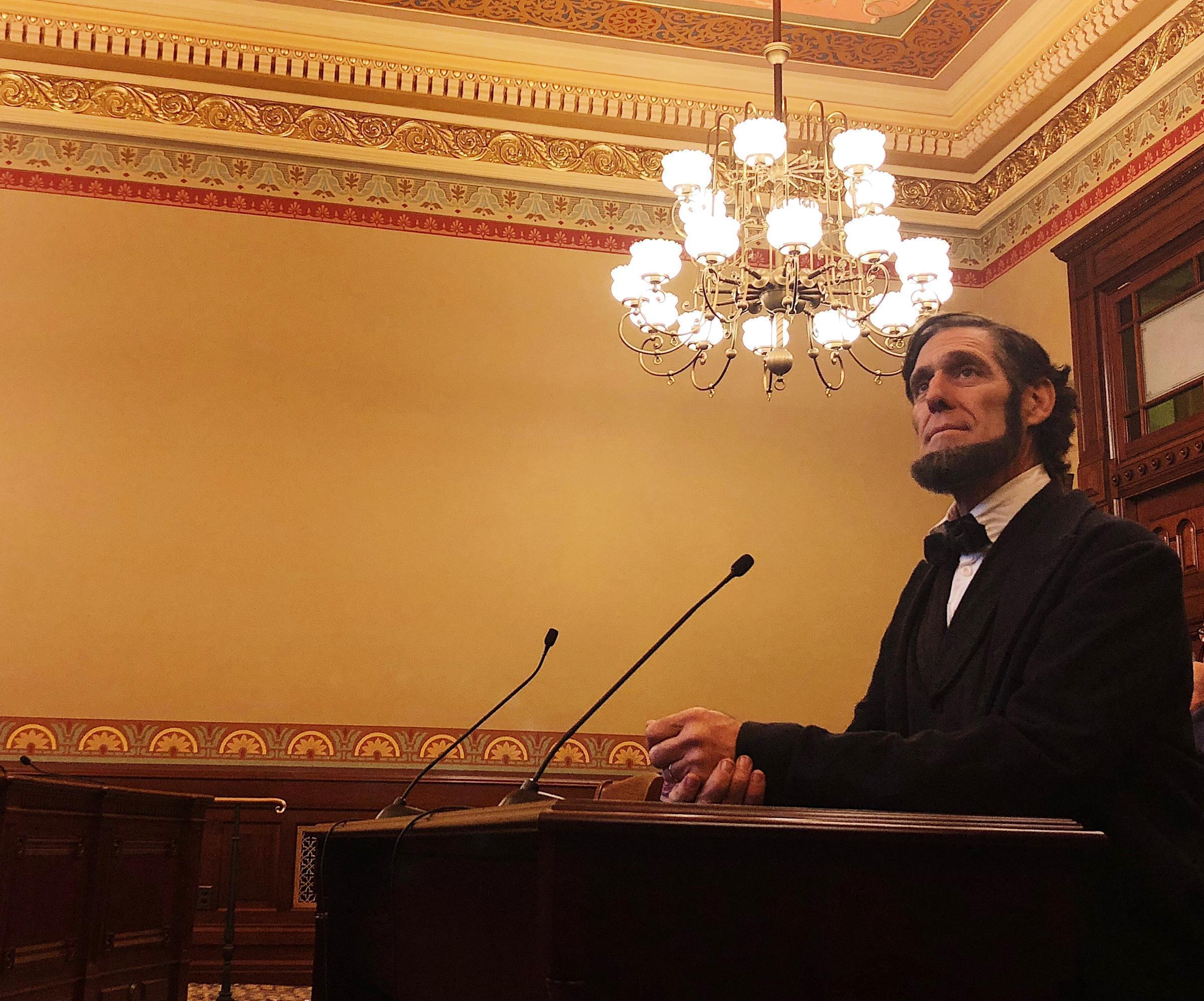 An Abraham Lincoln impersonator opens testimony during a House hearing for the Lincoln museum foundation.