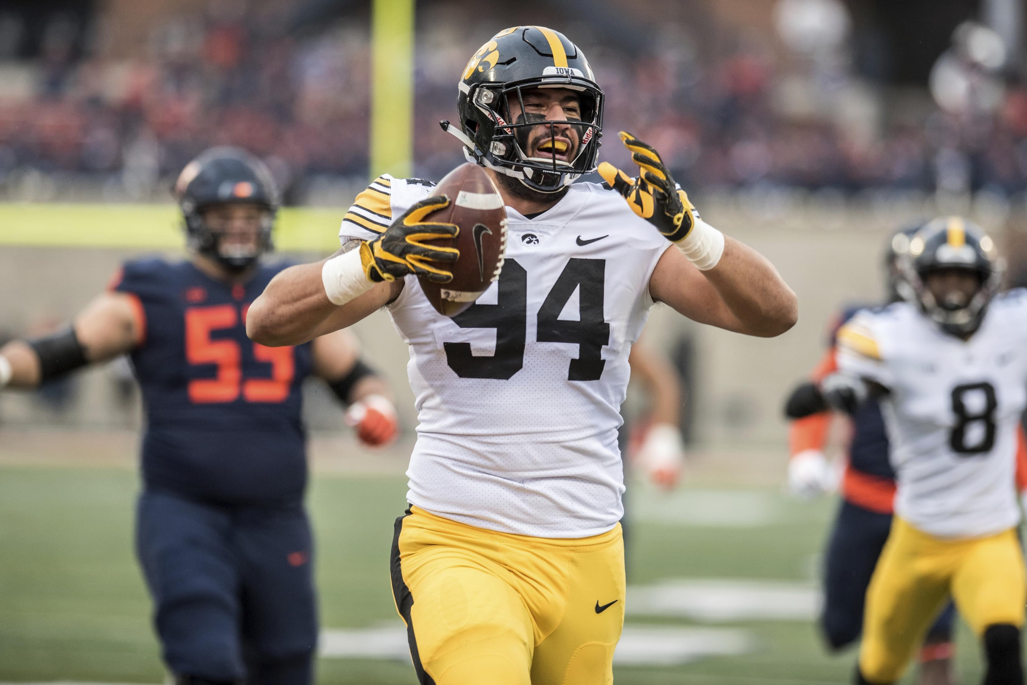 Iowa's A.J. Epenesa (94) celebrates after returning a fumble for a touchdown in the first half of a NCAA college football game against Illinois, Saturday, Nov. 17, 2018, in Champaign, Ill.